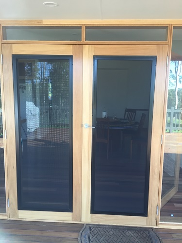 double-wooden-doors-with-glass-panels-covered-with-security-mesh-invsi-gard