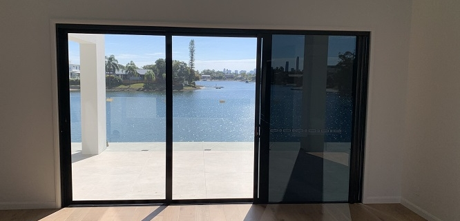 triple-glass-door-with-mesh-security-screen-ocean-views